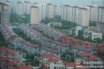 Rows of identical villas next to dozens of identical apartment blocks.