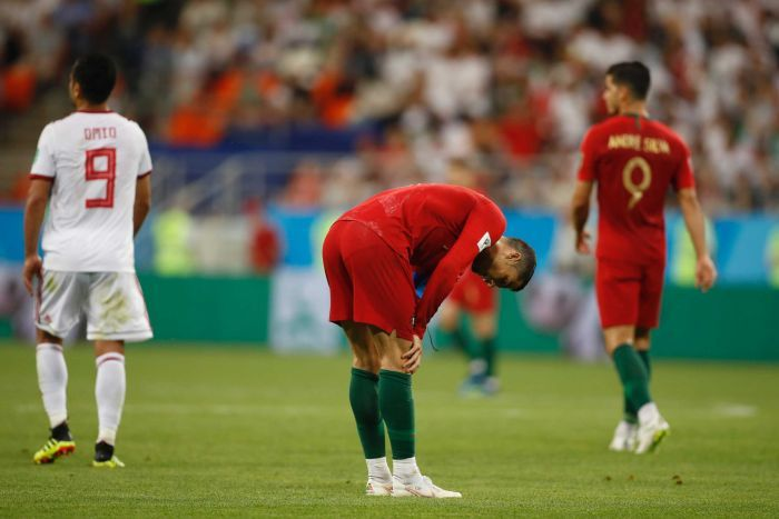 Cristiano Ronaldo holds his hands to his knees