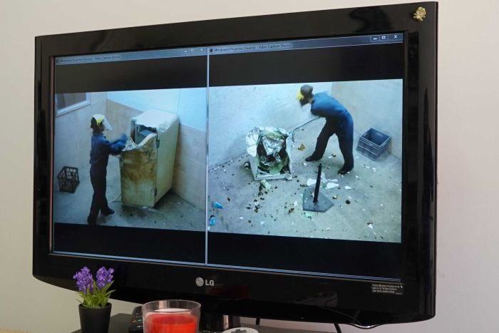 Screens display a live feed of security footage from inside the break rooms