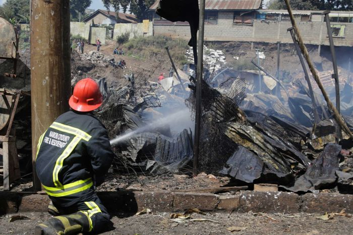 Fireman working after blaze in Nairobi market