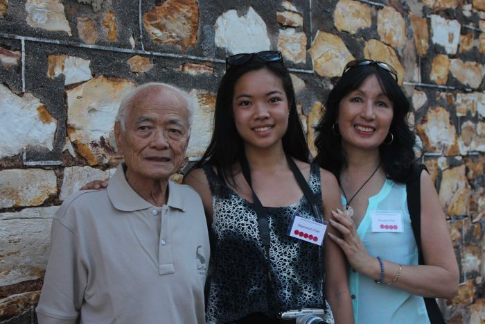 Hamilton Chan, Stephanie Chan and Rosalie Hiah pictured next to an exterior wall of the Stone House.