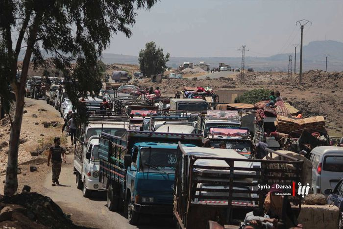 A long line of people in their vehicles fleeing from Daraa block the roads
