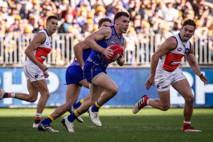 Luke Shuey makes a run with the ball for the Eagles against the Giants.