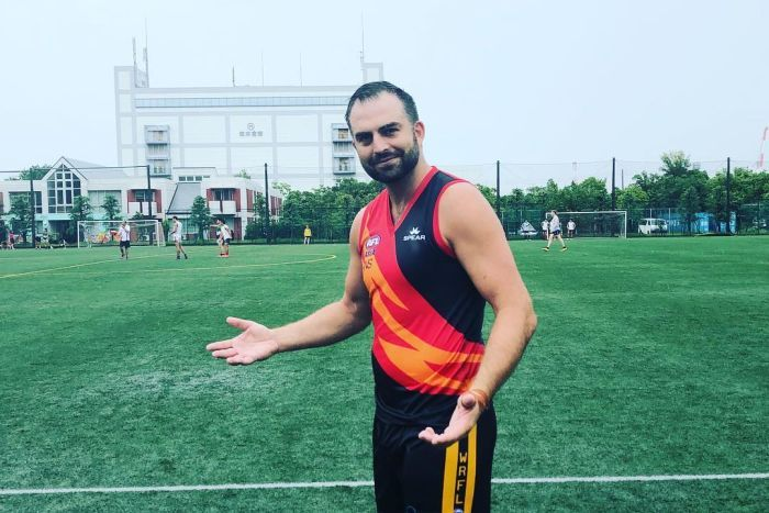 Brian Lake takes to the football field in Osaka for the Indonesian Volcanoes.