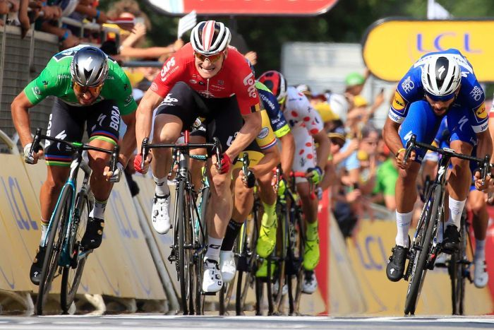 Fernando Gaviria (R), crosses the finish line to win the fourth stage of the 2018 Tour de France.