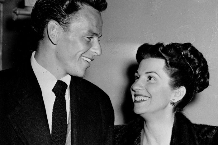 Singer Frank Sinatra and wife Nancy smile at one another