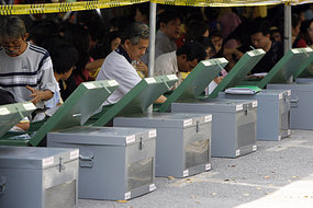 Officials check ballot boxes for Thailand's elections at a district office in Bangkok