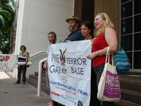 Photo shows the four protesters outside court following their successful appeal. (Jack Kerr)