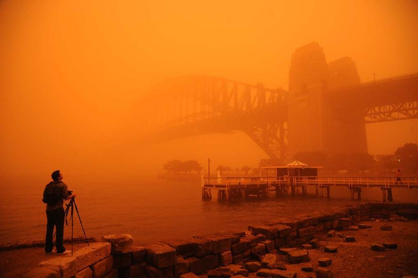 Red haze envelopes Sydney Harbour Bridge. (User submitted: Amber Hooper)