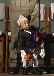Khagendra Thapa Magar expects to become the world's shortest man now he has turned 18. (Reuters: Gopal Chitrakar)