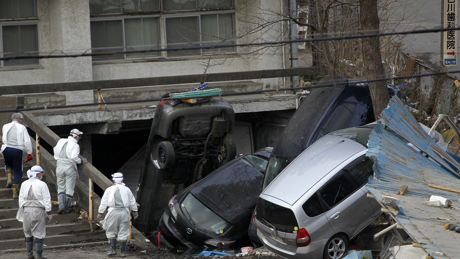 Cars piled up after twin disasters