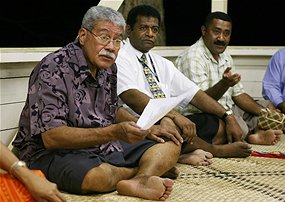 Former Fijian Prime Minister Laisenia Qarase (L) speaks with supporters at a Kava ceremony. [AFP]