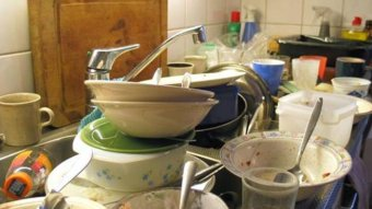 Dirty dishes in the sink (Gerard Oosterman)