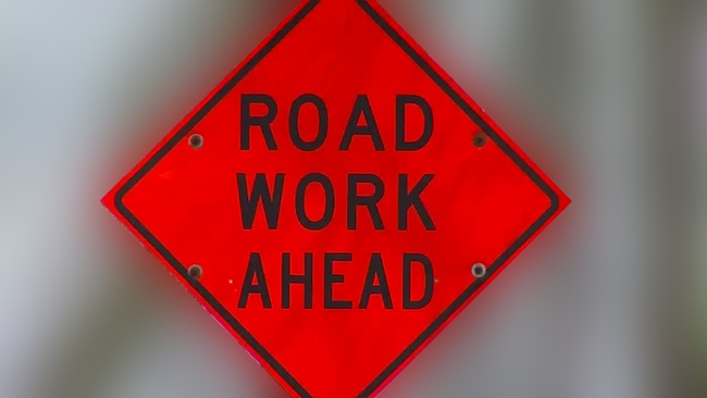 road_construction_ahead_sign_314024