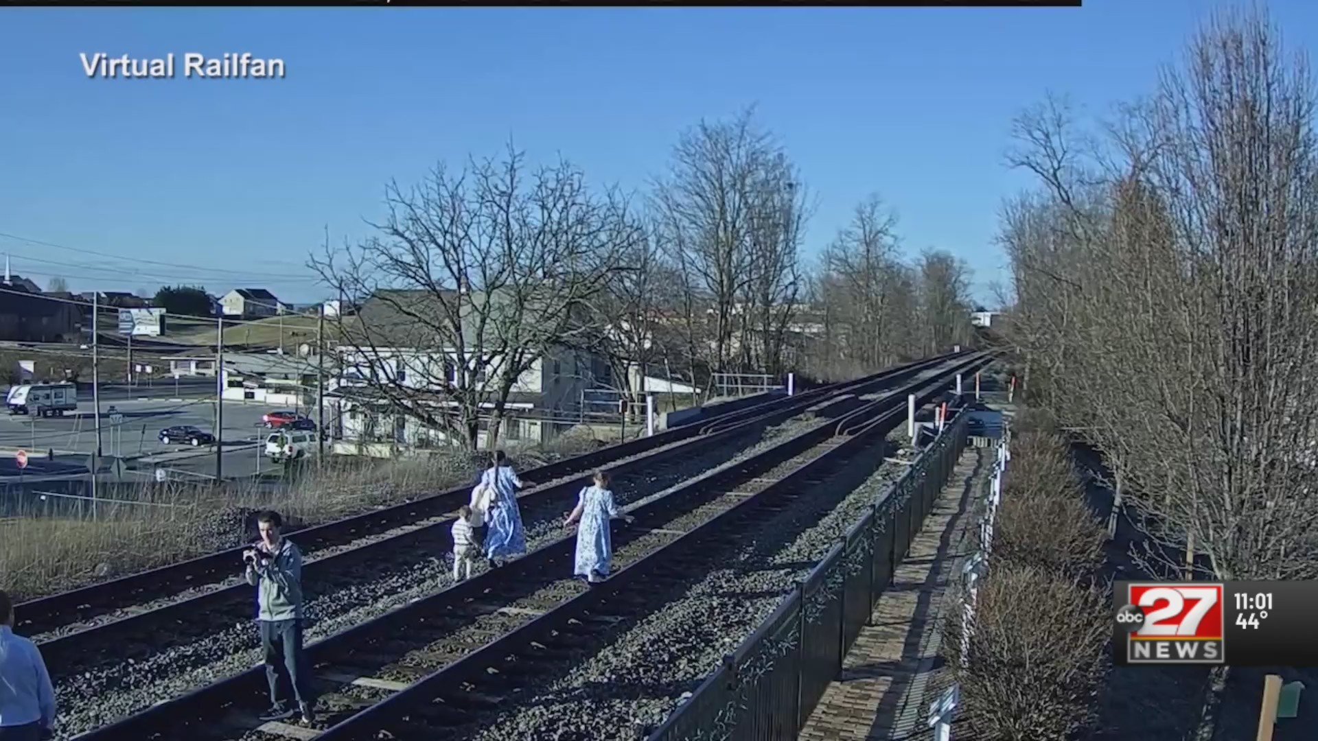 Family walks along tracks seconds before train barrels by
