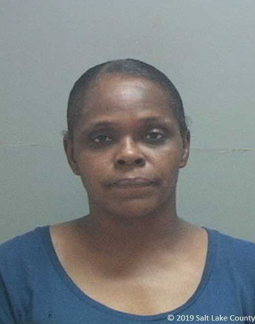 Wife of man accused of human trafficking charged with