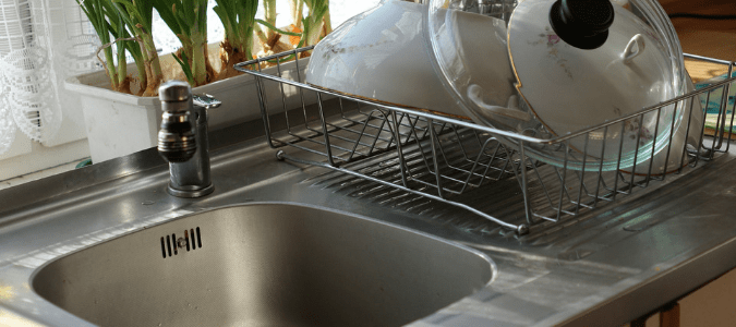 garbage disposal water comes back up