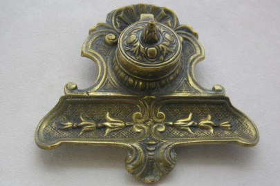 Cast brass desk stand with pen tray.