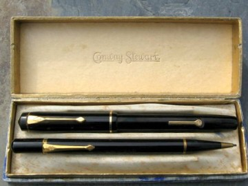 A near mint Conway Stewart No 759 lever filling fountain pen along with a Nippy pencil in black and  original box. The pen is fitted with a No 2 14ct gold medium nib priced at £75-00. Code PV313.