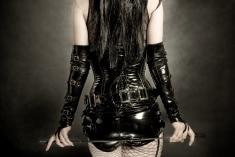 stock-photo-12388435-woman-in-black-latex-corset