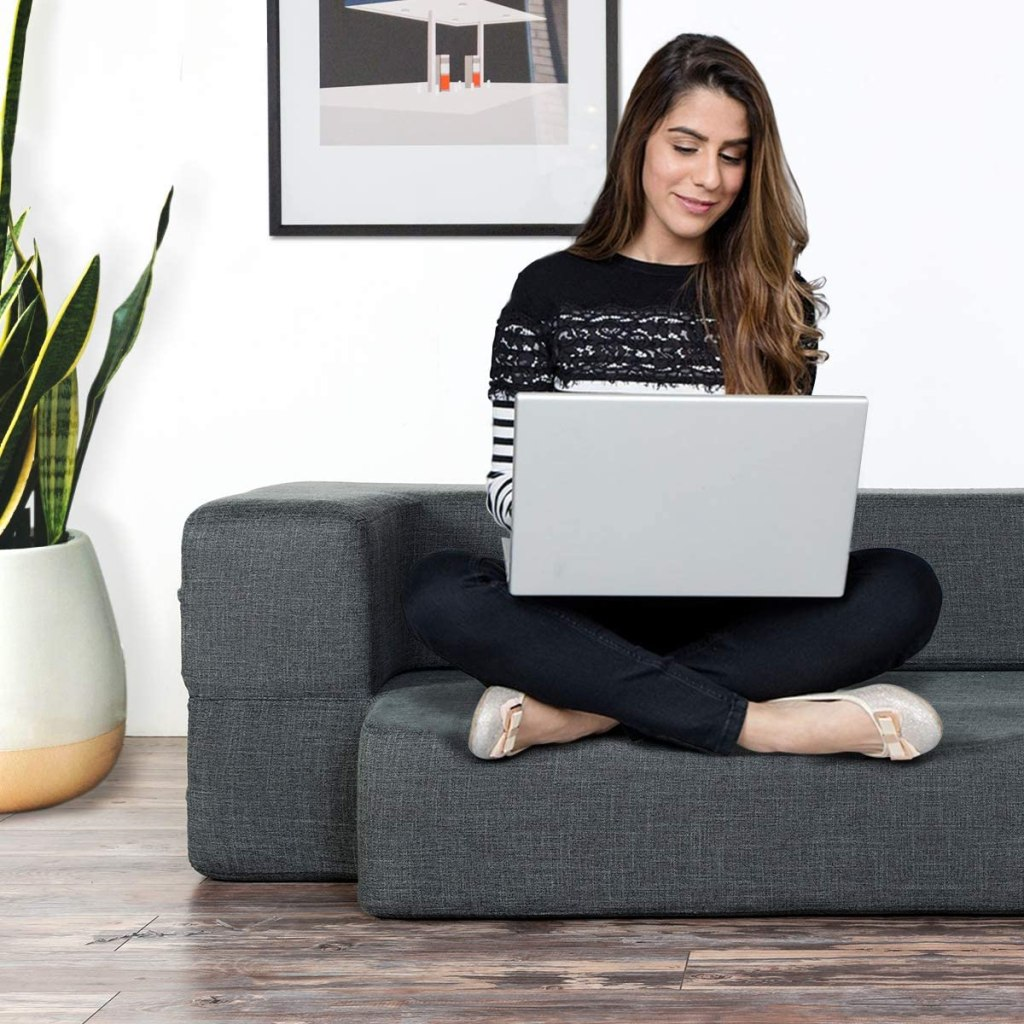woman-on-floor-sofa-couch-folded-up