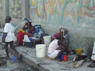 Haitian women and children huddle on the streets of Port-au-Prince - Flavia Cherry photo.