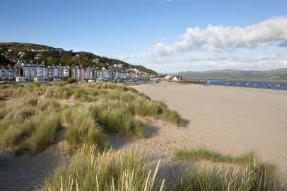 A view of the Aberdovey seafront and beach with some dunes
