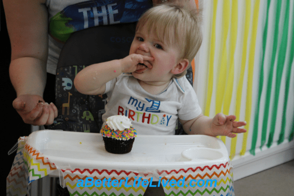 Enjoying the party and our first birthday cake!