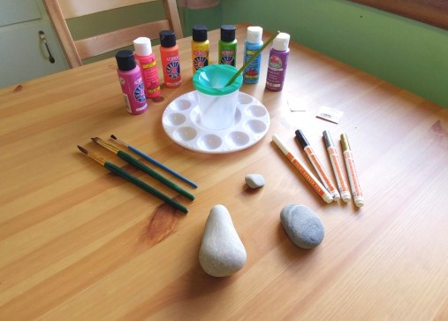 Supplies for Painting Kindness Rocks on a Table