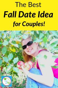 "Woman crouched under tree holding apples with text overlay "" The Best Fall Date Idea for Couples"""