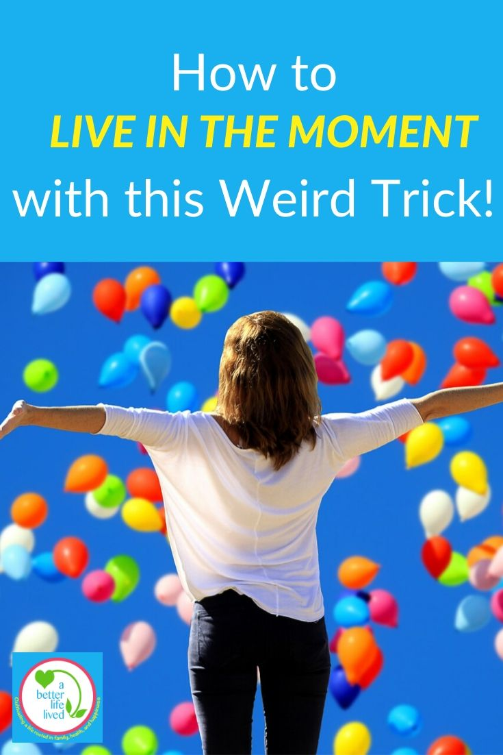 "Woman with arms open under balloons in the sky with text overlay ""How to Live in the Moment with this Weird Trick!"""