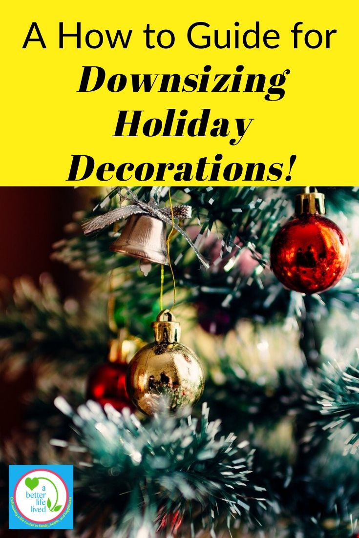 """Christmas ornaments on a tree with text overlay """"A how to guide for downsizing holiday decorations"""""""