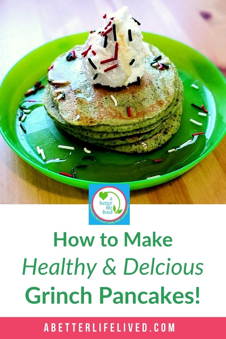 """Stack of green pancakes with whipped topping and sprinkles with text """"How to Make Healthy & Delicious Grinch Pancakes!"""""""