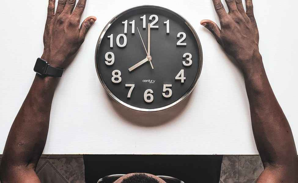 round silver colored wall clock