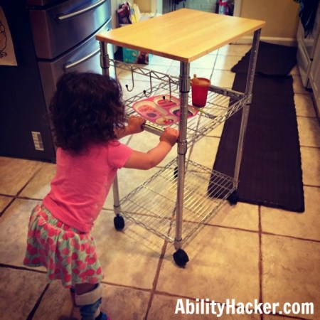 Using microwave cart to clear table for children with disabilities