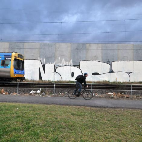 Nost Graffiti in train lane Melbourne