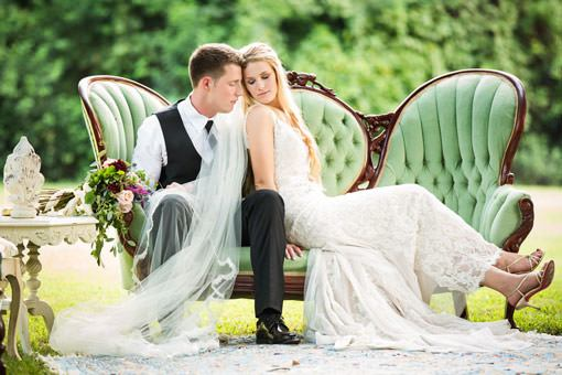 bride and groom sitting on vintage furniture at wedding in Columbia SC