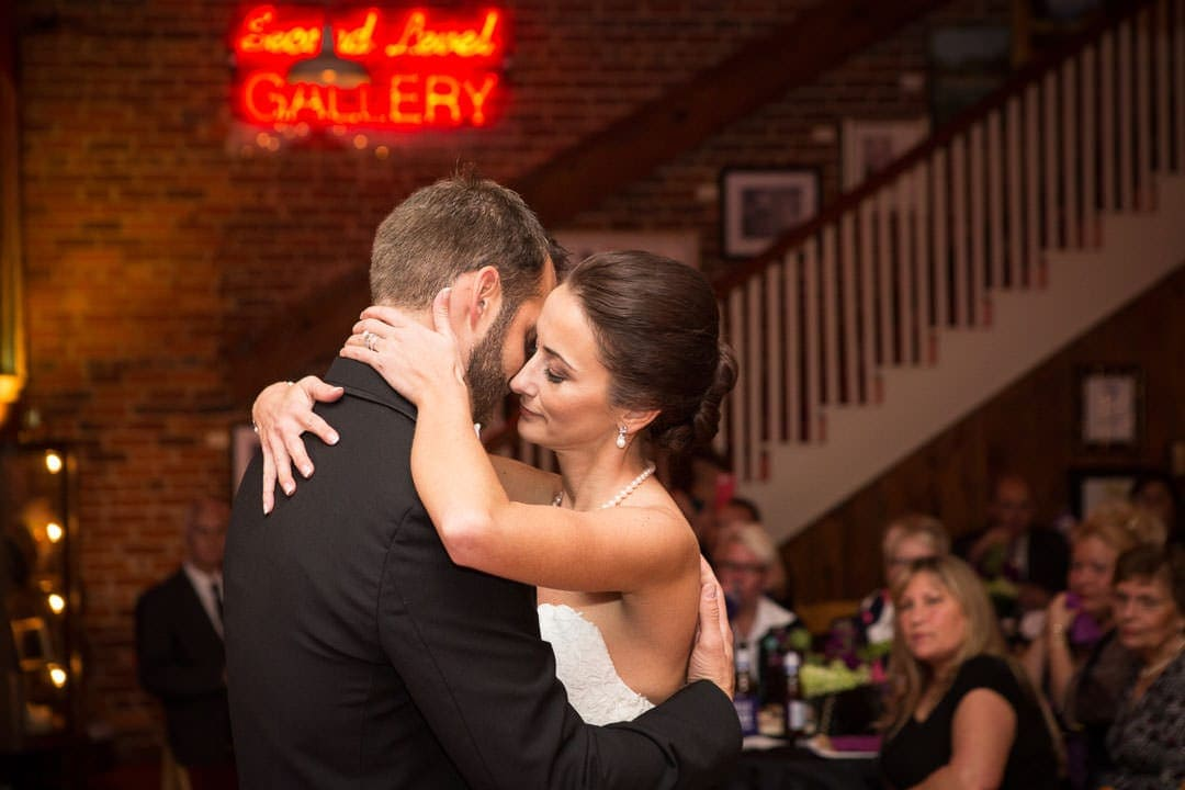 bride and groom first dance at city art gallery