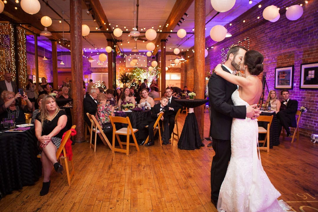 wide shot of the room during the first dance at city art gallery