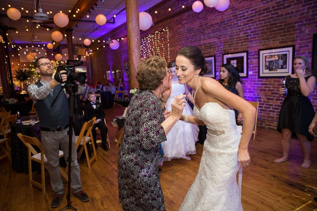 bride dances with family member at wedding reception