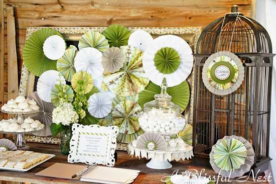 i love the way michelle styled this with simple elements like a rustic birdcage and all white and glass cake stands and a all white frame