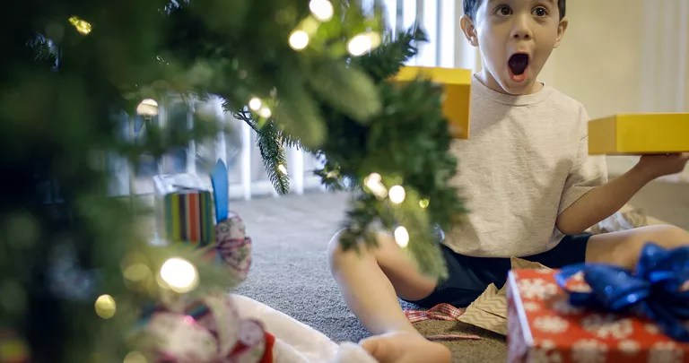 Boy opening gifts