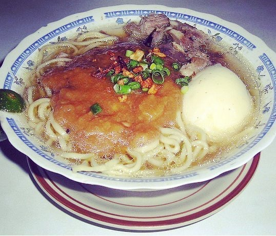 kinalas noodles and broth in bowl