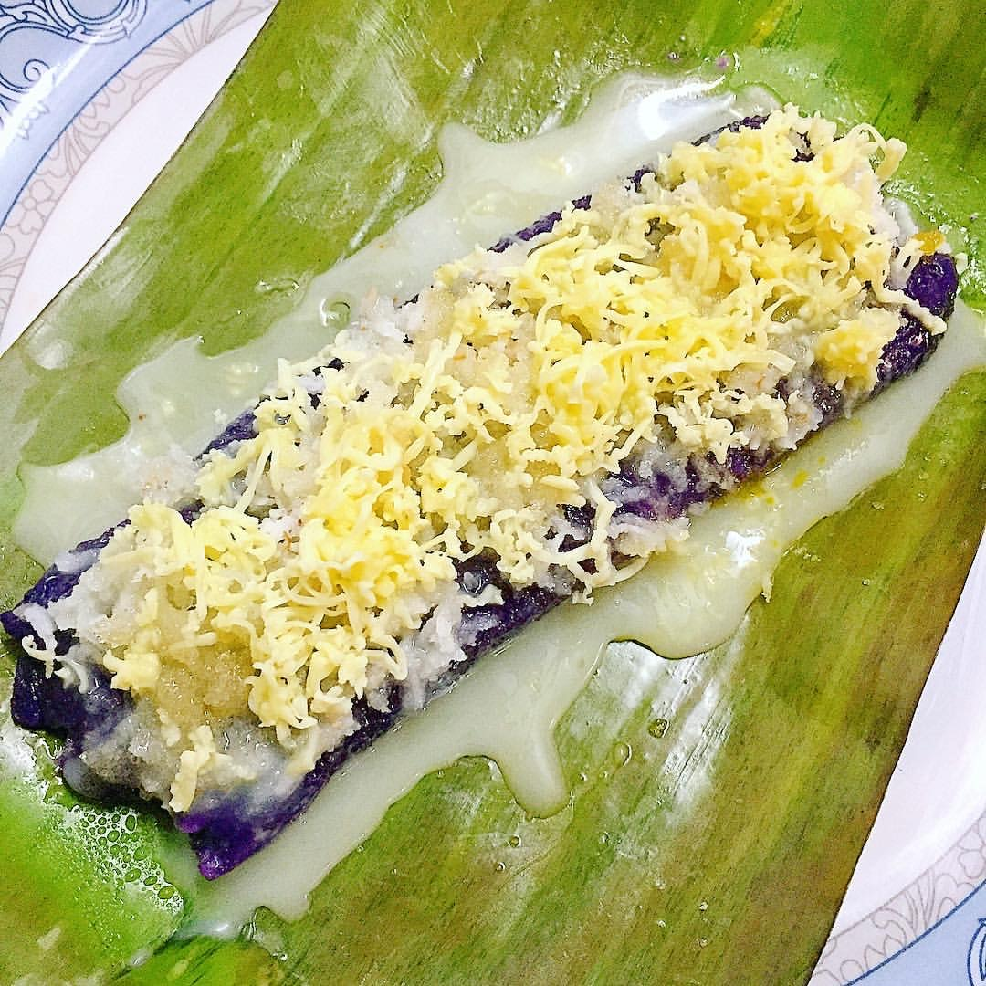 puto bumbong topped with cheese