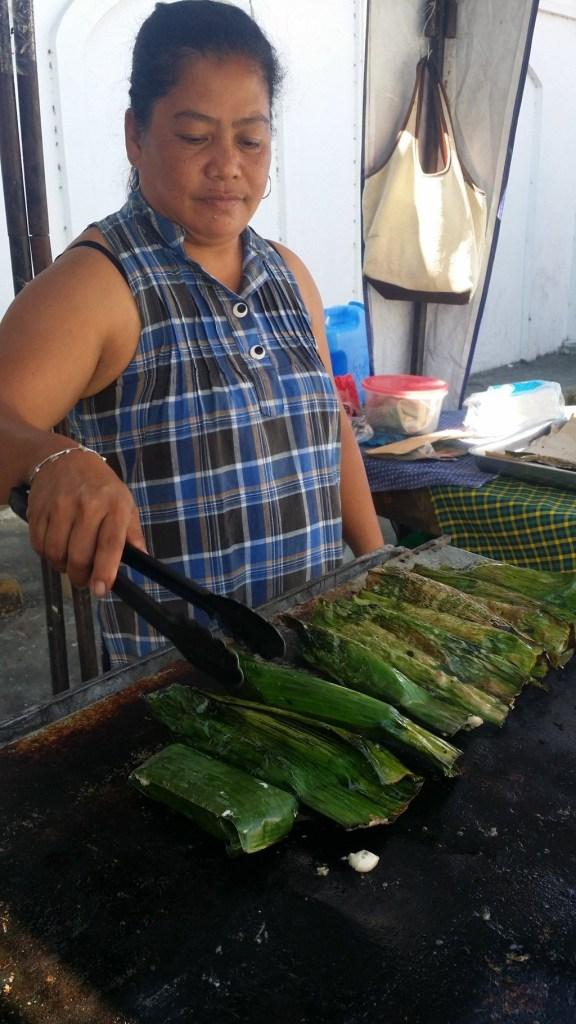 Woman cooking Tupig in Ilocos