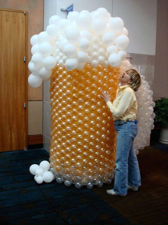 Beer anyone? Cherokee Distributing celebrated 50 years with 7' tall beer mugs at its celebration entrance