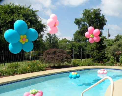 Floating flowers make for a festive pool