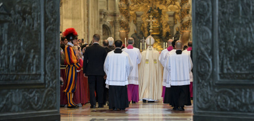 Pope Francis leaves at the end of a ceremony where he formally announced an Extraordinary Jubilee year, in St. Peter's Basilica, at the Vatican, Saturday, April 11, 2015. Pope Francis has proclaimed a special year of efforts by the Catholic Church to be more merciful and less judgmental. At St. Peter's Basilica Saturday evening, he listened as a Vatican prelate read excerpts from a papal bull, or decree, in which Francis proclaimed an