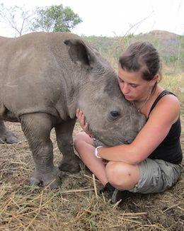 baby rhino hug