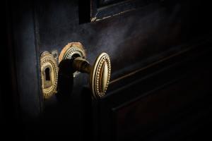 detail of antique golden door handle knob